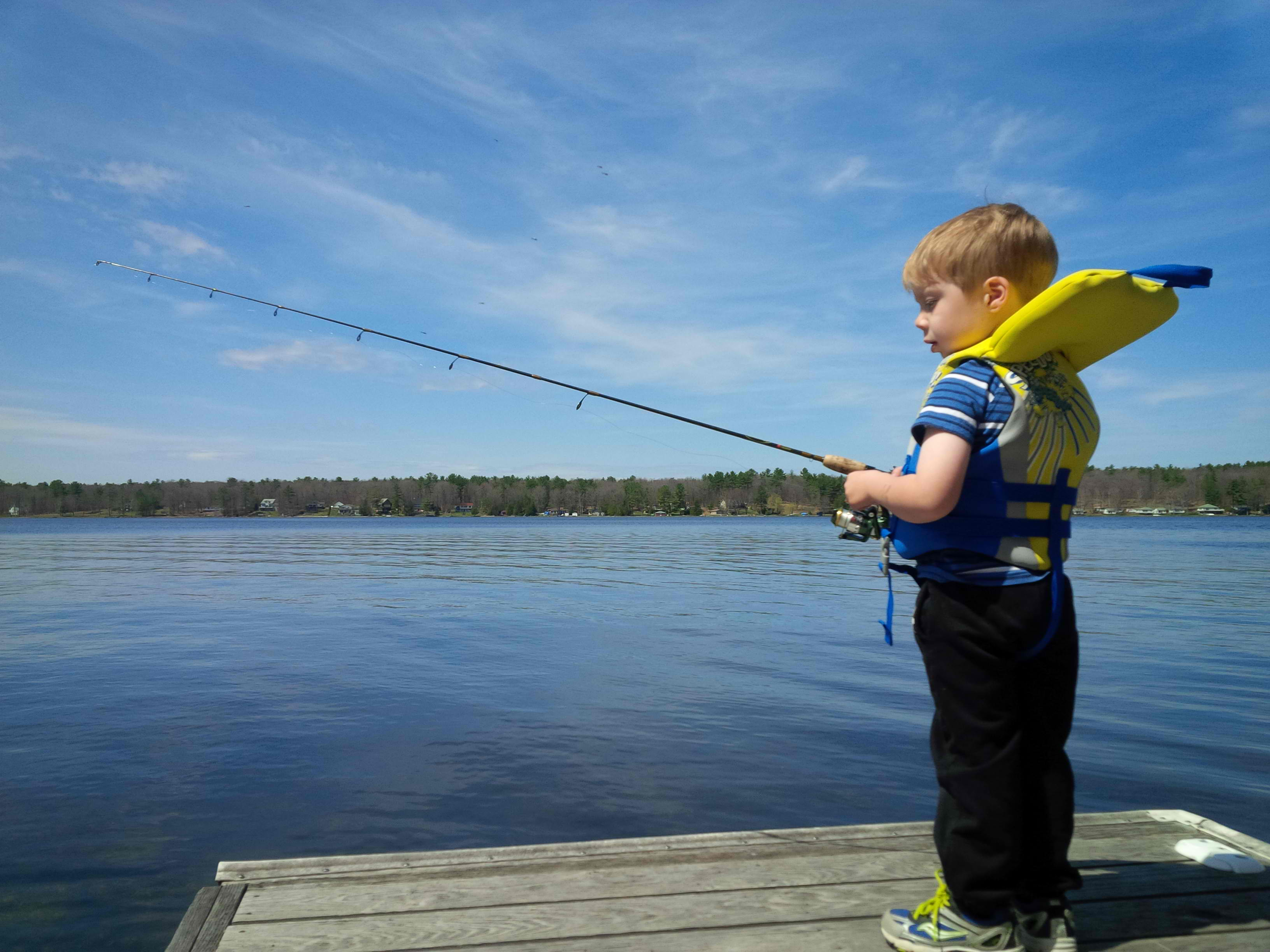 Andrew-Shufelt-Boy-on-Dock-with-Fishing-Rod1
